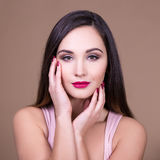 Make up and beauty concept - portrait of young beautiful woman w Stock Images