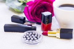 Cosmetics with a rose royalty free stock photos