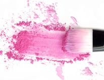 Make up blush on crushed pink powder. Royalty Free Stock Photography