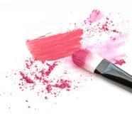 Make up blush crushed powder and lipstick smeared.  Royalty Free Stock Image
