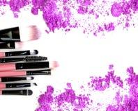 Make up blush and crushed powder. Purple powder.  royalty free stock images