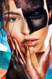 Composition of women portraits with glitters on face and hands stock photography