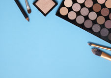 Make-up border - blue. Make-up on a blue background Royalty Free Stock Images