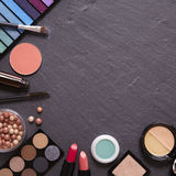 Make-up border. Make-up on a slate background Stock Image