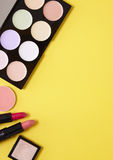 Make-up border. Make-up on a yellow background Royalty Free Stock Photos