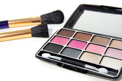 A make-up box. With two brushes isolated over white royalty free stock photo