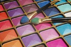 Make up with brash. Close up, shining eyeshadow set Stock Image