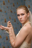 Make-up of the bride. The girl with a brush for eyelids Stock Photos