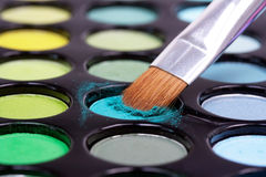 Make-up brush in blue eyeshadows Royalty Free Stock Photos