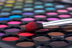 Make-up brush on color shadows stock image
