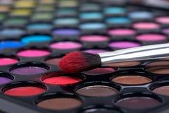 Make-up brush on color shadows Stock Image