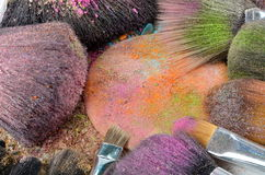Make-up brush on colorful crushed eyeshadow Royalty Free Stock Image