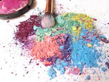 Make-up brush on colorful crushed eyeshadow stock photos
