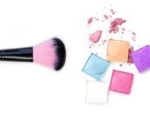 Make-up brush with colorful crushed eyeshadows. royalty free stock image