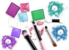 Make-up brush with colorful crushed eyeshadows. stock image