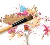 Make-up brush with colorful crushed mixed colors eyeshadows. Stock Images
