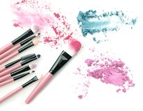 Make-up brush with colorful crushed mixed colors eyeshadows. Stock Photos