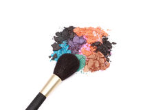 Make-up brush and colors. Make-up brush with makeup colors isolated on white Royalty Free Stock Image