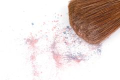 Make-up brush with crumbled eyeshadows Royalty Free Stock Images