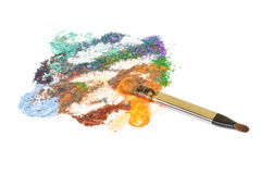 Make-up brush on crushed blue eye shadows Royalty Free Stock Images