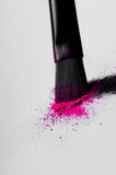 Make-up brush with crushed eyeshadows Stock Photo