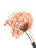 Make-up brush and crushed face powder stock images