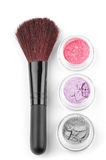 Make-up brush and eye shadows Royalty Free Stock Image