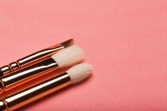 Make up brush, eye shadows blusher isolated on pink background.  stock photography