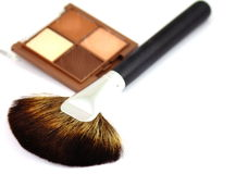 Make up brush and eyeshadows Stock Photos