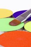 Make-up brush on eyeshadows palette Stock Photos