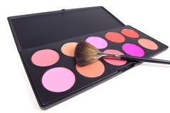 Make-up brush on eyeshadows palette Royalty Free Stock Image
