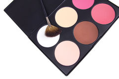 Make-up brush on eyeshadows palette Stock Images