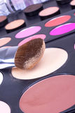 Make-up brush on eyeshadows palettes Stock Image