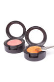 Make-up brush on eyeshadows in round box Royalty Free Stock Image