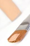 Make-up brush with foundation Stock Image