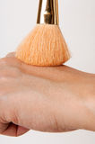 Make up brush and hand. For beauty and cosmetic use Stock Images