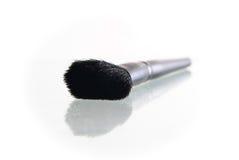 Make-up brush isolated on the white background. Powder makeup brush on the reflect background Stock Image