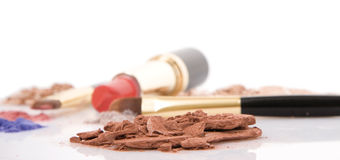 Make-up brush, lipstick and different powder stock images