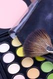 Make-up brush on multicolour eyeshadows palette Royalty Free Stock Images