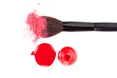 Make up brush and Nail polish. Make up brush with pink facial powder and red nail polish and splatter on white background, top view with clipping path. Feminine Stock Photography