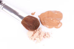 Make-up brush near eyeshadow and foundation Stock Photos