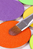 Make-up brush on orange eye shadows palette Royalty Free Stock Image