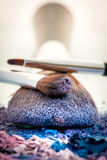 Make up brush. With pink , purple and blue shades Royalty Free Stock Photo
