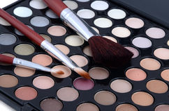 Make-up brush and powder eye shadows Stock Images