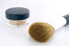 Make-up brush and powder jar Royalty Free Stock Photo