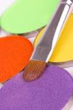 Make-up brush on professional eyeshadows pallete Royalty Free Stock Images