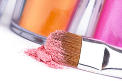 Make-up brush and tubes with  eyeshadows Stock Photos