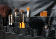 Make-up brushes in a bag Stock Photography