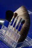 Make-up brushes on blue Stock Photos