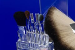 Make-up brushes on blue Royalty Free Stock Photography